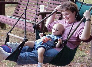 Sue and her son enjoy a quiet moment on the swings